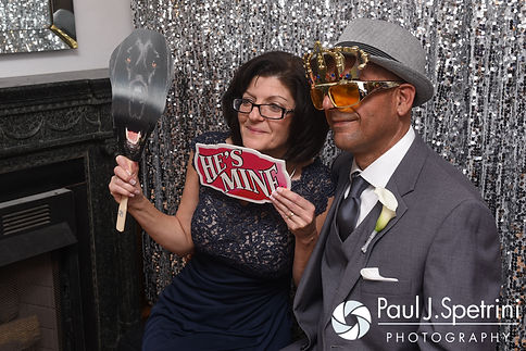 Guests use the photo booth during Marissa and Paul's September 2016 wedding reception at the Aqua Blue Hotel in Narragansett, Rhode Island.