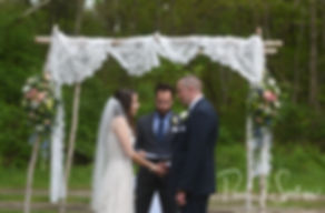 Ryan and Mike exchange rings during their May 2018 wedding ceremony at Bittersweet Farm in Westport, Massachusetts.