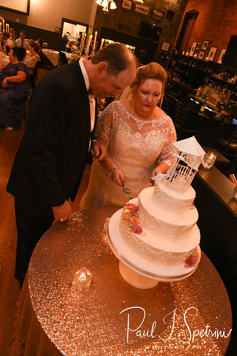 Patti and Bob cut their wedding cake during their August 2018 wedding reception at the Olde Colonial Cafe in Norwood, Massachusetts.
