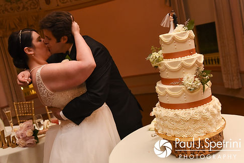 Allison and Len cut the cake during their September 2017 wedding reception at the Roger Williams Park Casino in Providence, Rhode Island.