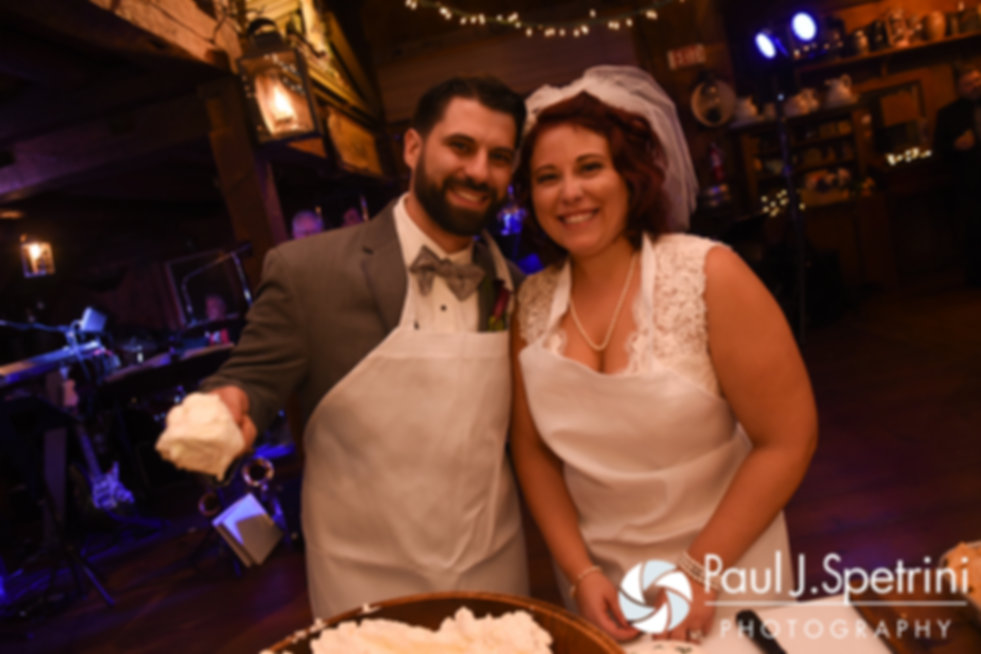 Crystal and Andy smile for a photo during their November 2016 wedding reception at the Salem Cross Inn in West Brookfield, Massachusetts.