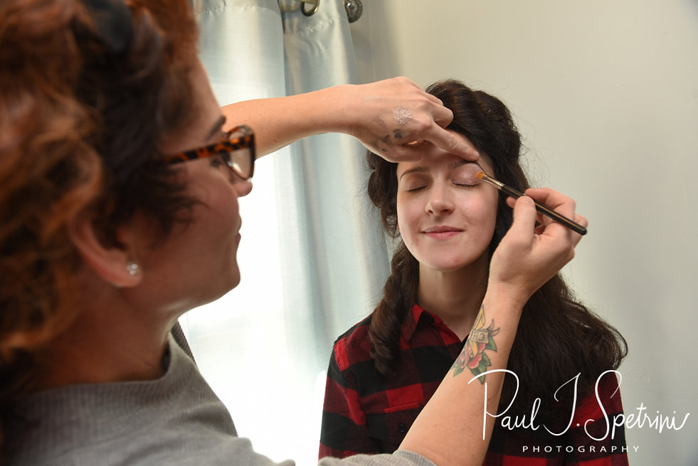 Stacey has her makeup done during her bridal prep session at in Attleboro, Massachusetts.