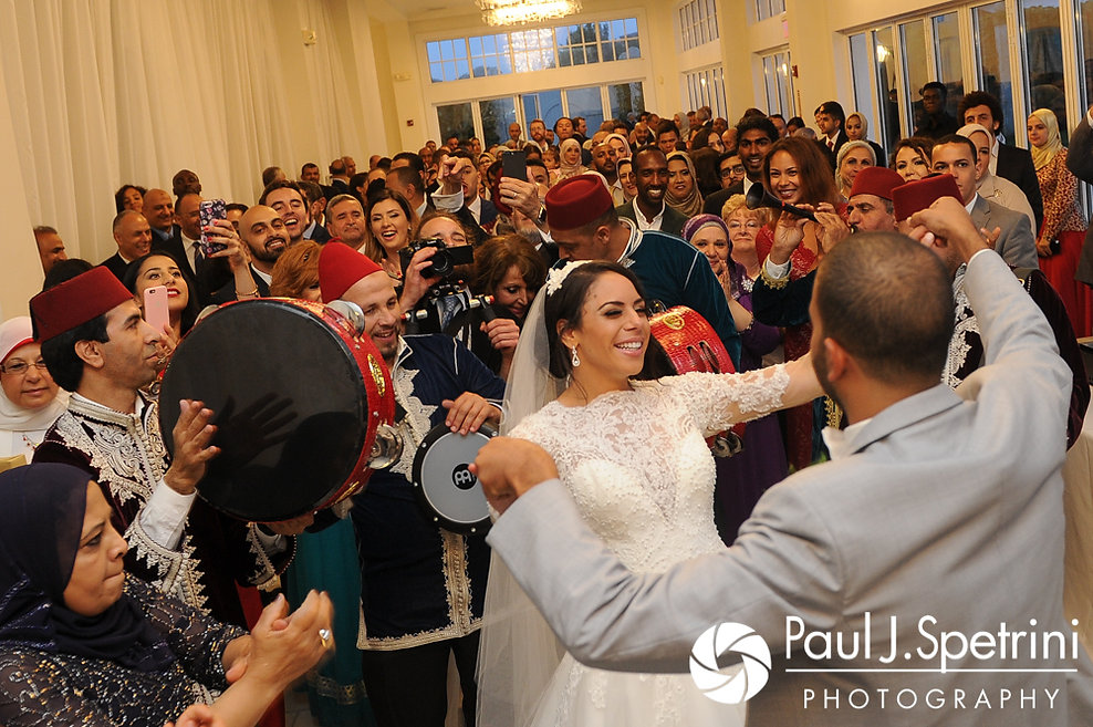 Nashua and Nader walk into their July 2017 wedding reception at Belle Mer in Newport, Rhode Island.