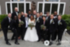 Forrester and Lisajean pose for a photo with their wedding party following their October 2016 wedding ceremony at St. Thomas More Church in Narragansett, Rhode Island.