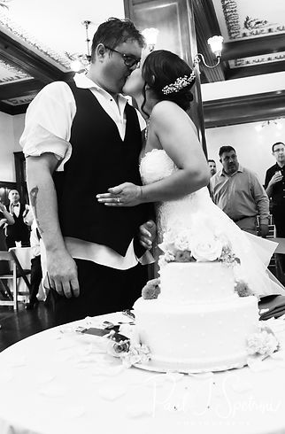 Danielle & Mark cut their wedding cake during their August 2018 wedding reception at the Roger Williams Park Casino in Providence, Rhode Island.