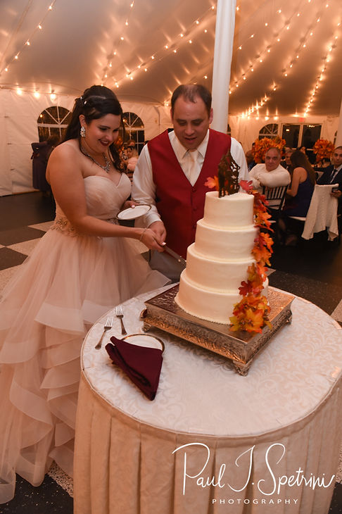 Rich & Makayla cut their wedding cake during their October 2018 wedding reception at Zukas Hilltop Barn in Spencer, Massachusetts.