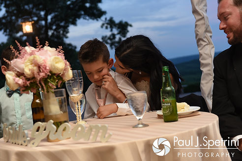 Lauryn and her son embrace during her July 2016 wedding reception at the Overlook at Geer Tree Farm in Griswold, Connecticut.