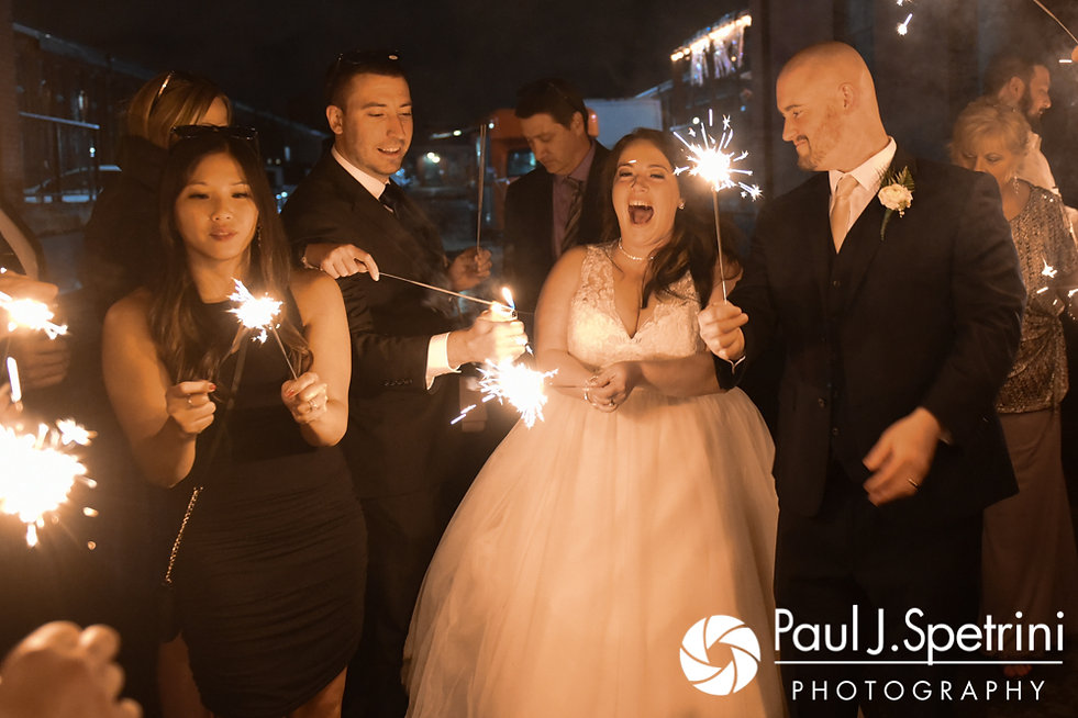Meridith and Matthew light sparklers following their May 2017 wedding reception at the Hope Artiste Village in Pawtucket, Rhode Island.