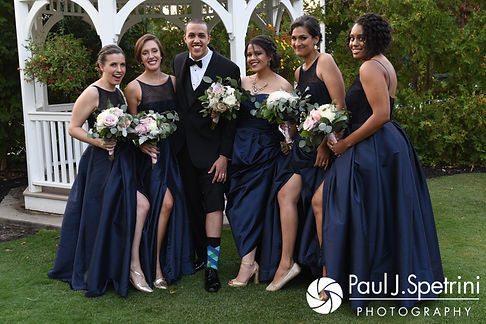 Arten poses for a photo with the bridesmaids following his September 2017 wedding ceremony at Wannamoisett Country Club in Rumford, Rhode Island.