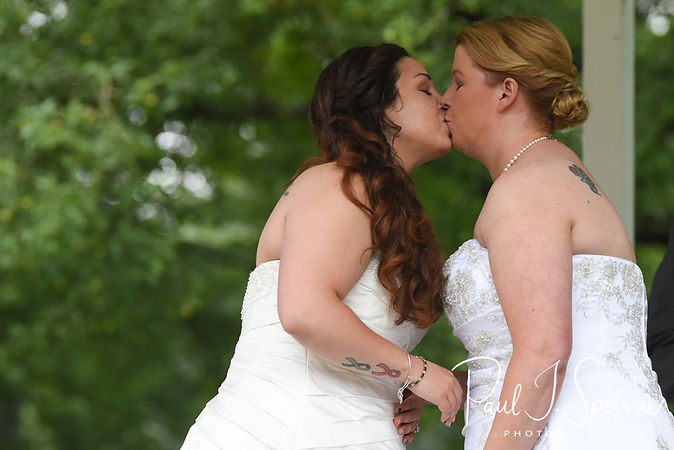 Laura and Marijke kiss during their June 2018 wedding ceremony at Independence Harbor in Assonet, Massachusetts.