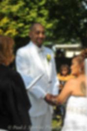 Joe Andrade smiles at his wedding.