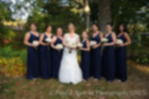 Kerry and her bridesmaids smile for a photo prior to her fall wedding at Quidnessett Country Club in North Kingstown, Rhode Island on October 23rd, 2015.