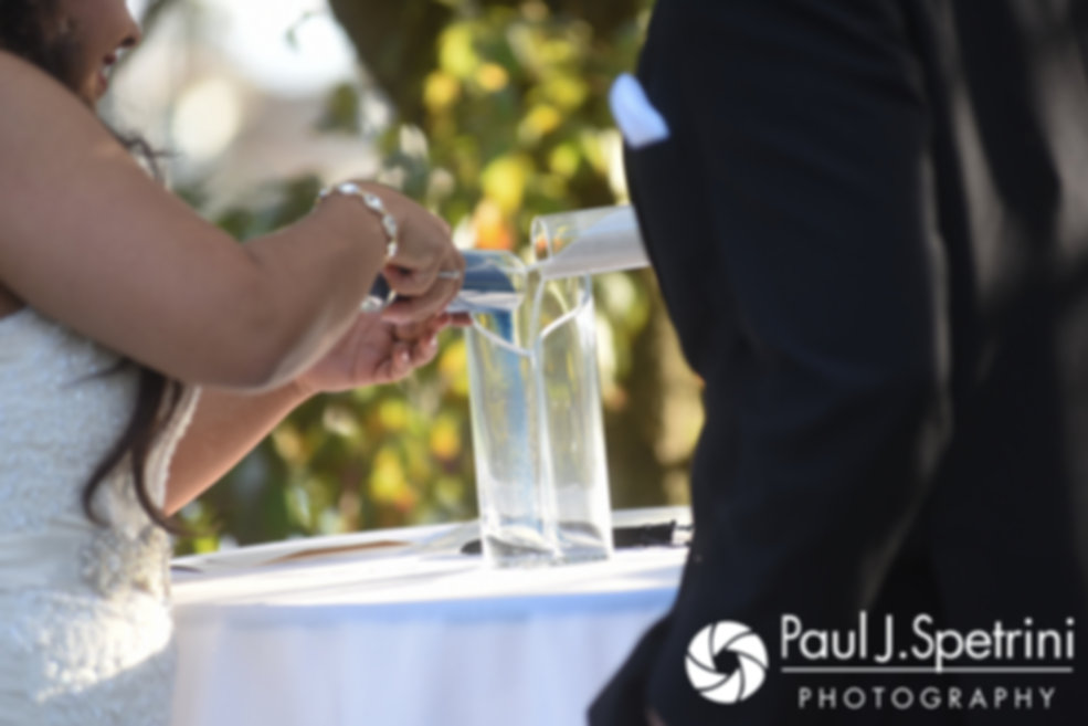 Stephany and Arten participate in a sand pouring ceremony during their September 2017 wedding ceremony at Wannamoisett Country Club in Rumford, Rhode Island.