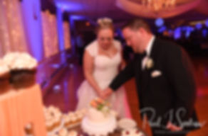 Patrick & Courtney cut their wedding cake during their September 2018 wedding reception at Valley Country Club in Warwick, Rhode Island.