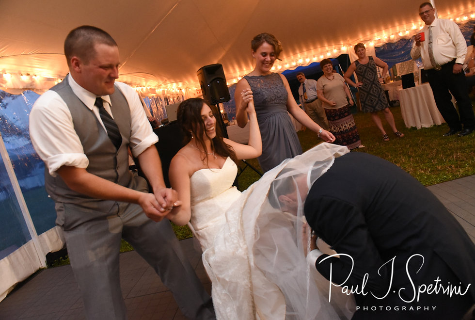 Karolyn and Ethan participate in a garter ceremony during their August 2018 wedding reception at a private residence in Sterling, Connecticut.