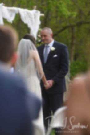 Mike look at Ryan during his May 2018 wedding ceremony at Bittersweet Farm in Westport, Massachusetts.