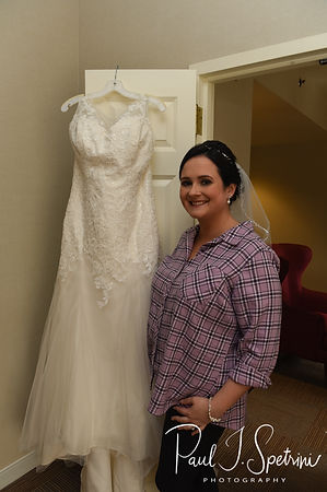 Justine poses for a photo near her dress prior to her October 2018 wedding ceremony at Twelve Acres in Smithfield, Rhode Island.