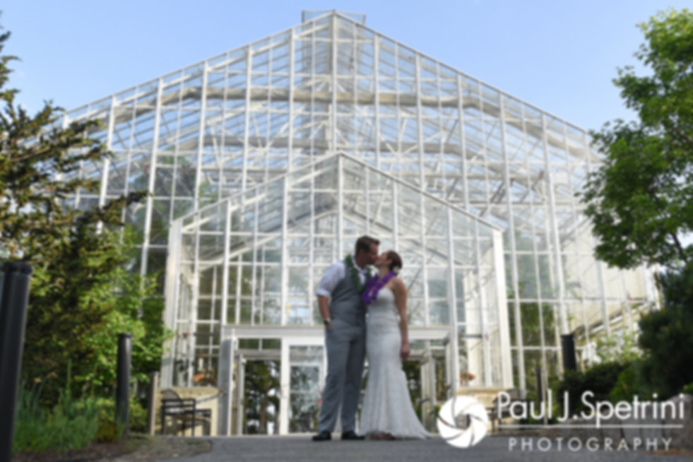 Will and Jess share a kiss during a formal photo taken during their May 2017 wedding reception at the Roger Williams Park Botanical Center in Providence, Rhode Island.
