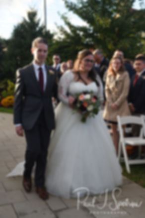 Katie walks down the aisle during her October 2018 wedding ceremony at The Villa at Ridder Country Club in East Bridgewater, Massachusetts.
