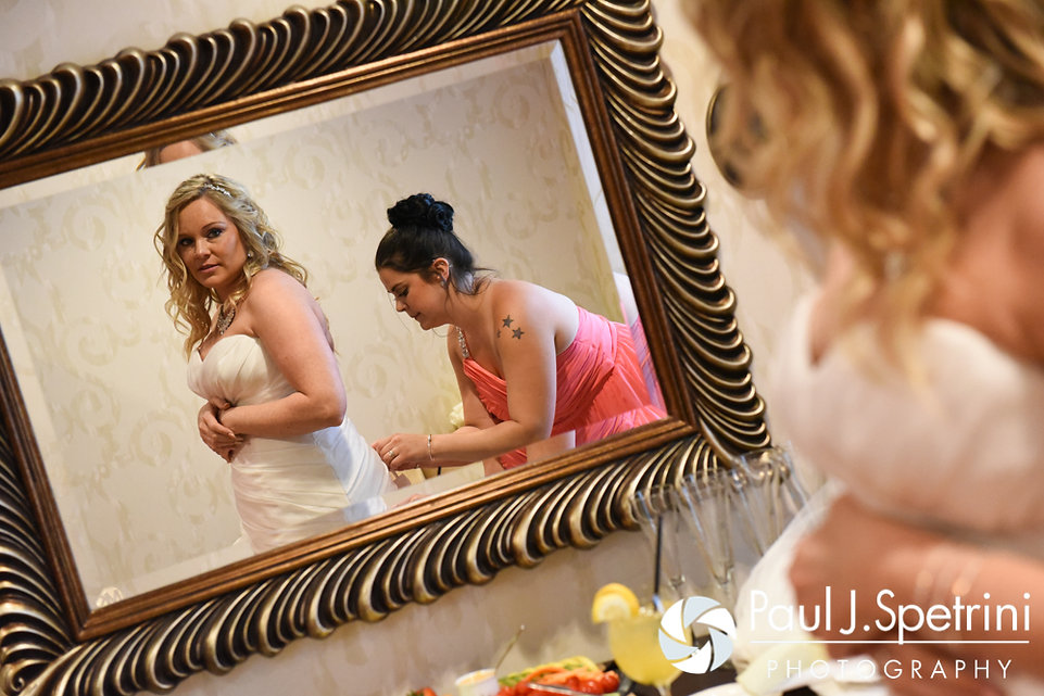 Michelle takes a look at herself in the mirror prior to her May 2016 wedding at Hillside Country Club in Rehoboth, Massachusetts.
