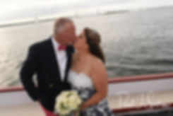 Mike & Kate kiss during a formal photo following their May 2018 wedding ceremony aboard the Schooner Aurora boat in the waters off Newport, Rhode Island.