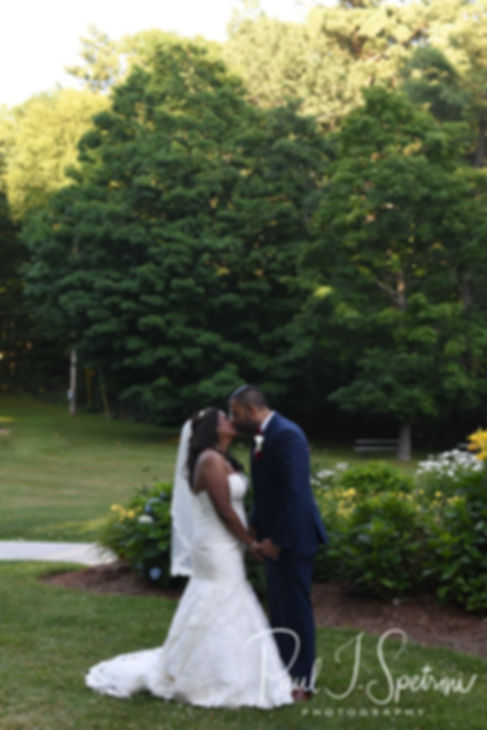 Jimmy & Saken pose for a formal photo following their July 2018 wedding ceremony at Lake Pearl in Wrentham, Massachusetts.