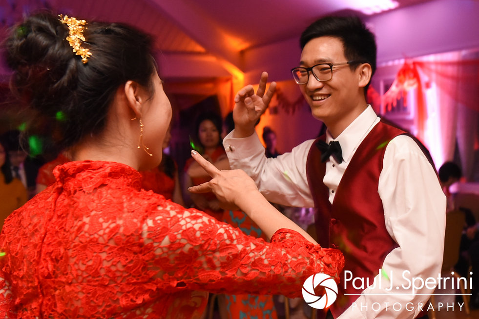 Cynthia and Ao dance during their August 2017 wedding reception at Lake Pearl in Wrentham, Massachusetts.
