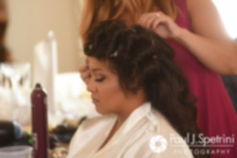 Stephany has her hair done prior to her September 2017 wedding ceremony at Wannamoisett Country Club in Rumford, Rhode Island.