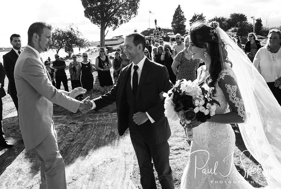 Bryan shakes Beth's dad's hand during his August 2018 wedding ceremony at Fort Phoenix in Fairhaven, Massachusetts.