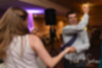 Guests dance during Brian & Sarah's June 2018 wedding reception at Pleasant Valley Country Club in Sutton, Massachusetts.