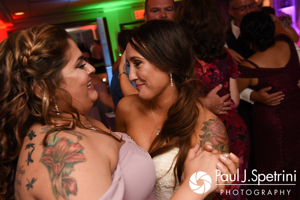 Stacey smiles with her maid of honor during her September 2017 wedding reception in Warren, Rhode Island.