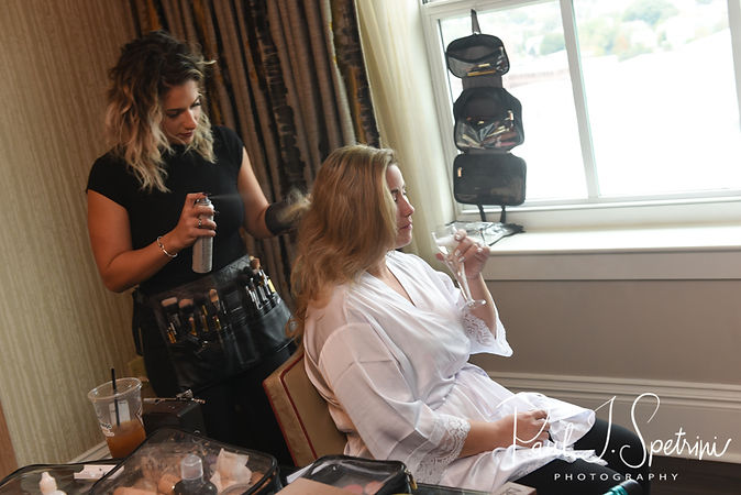 Sarah has her hair done during her bridal prep session at The Omni Hotel in Providence, Rhode Island prior to her October 2018 wedding.