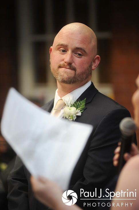 Matthew listens to Meridith's sister during his May 2017 wedding ceremony at the Hope Artiste Village in Pawtucket, Rhode Island.