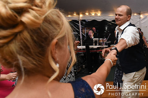 Kelly dances with Rebecca's matron of honor during his August 2017 wedding reception in Warwick, Rhode Island.