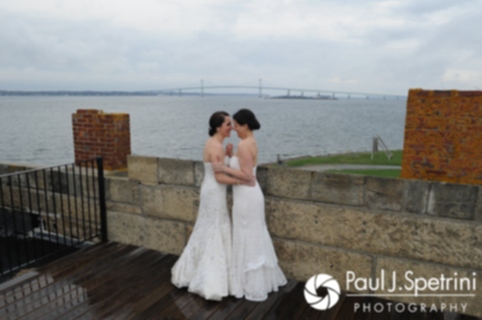 Caroline and Morgan share a moment together following their April wedding ceremony at the Fort Adams Trust in Newport, Rhode Island.