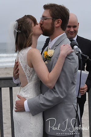 Justin and Amber kiss during their June 2018 wedding ceremony at North Beach Clubhouse in Narragansett, Rhode Island.