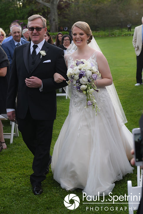 Melissa and her father walk down the aisle during her May 2017 wedding ceremony at Independence Harbor in Assonet, Massachusetts.