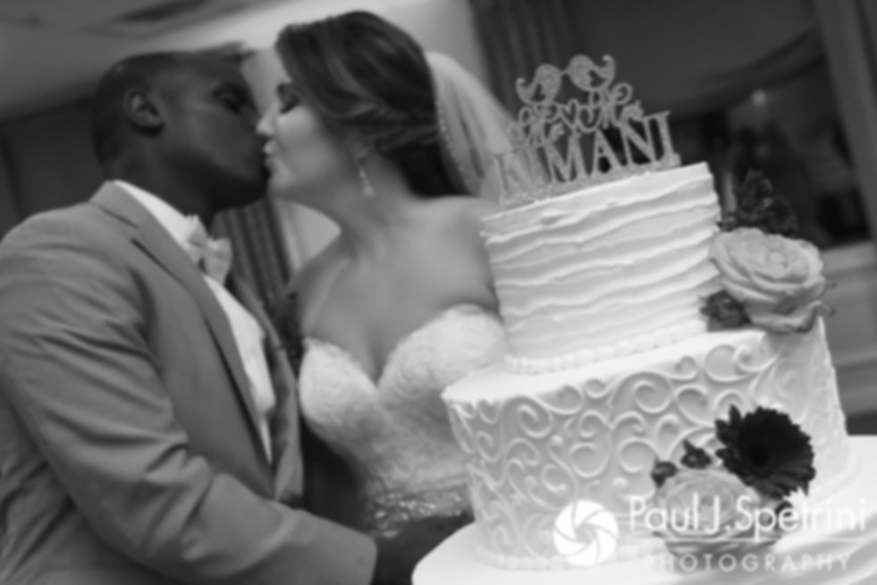 Kevin and Kristina kiss after cutting their wedding cake during their October 2017 wedding reception at the Villa Ridder Country Club in East Bridgewater, Massachusetts.