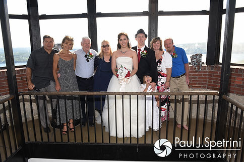Amanda and Chris' family members smile for a photo following their summer wedding at the Quabbin Reservoir Observation Tower in Belchertown, Massachusetts on July 2nd, 2016.