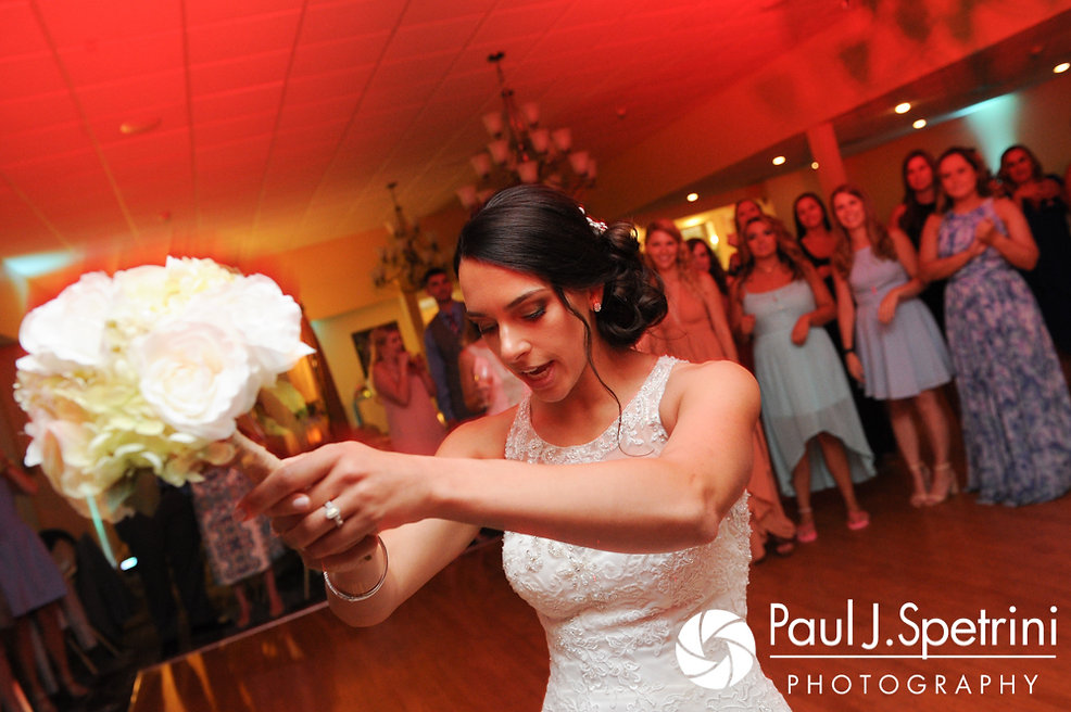 Cassie gets ready to toss the bouquet during her July 2017 wedding reception at Rachel's Lakeside in Dartmouth, Massachusetts.