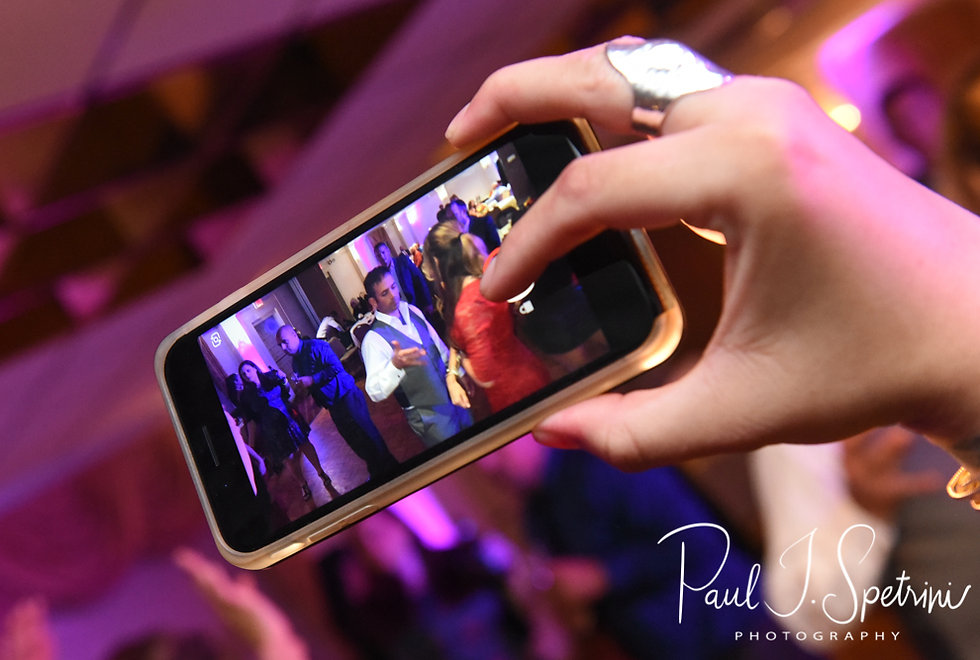 A guests records a video during Justine & Jon's October 2018 wedding reception at Twelve Acres in Smithfield, Rhode Island.