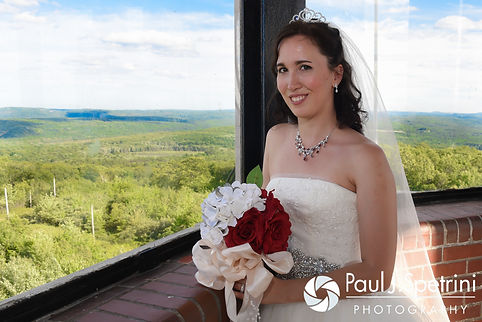 Amanda poses for a photo following her summer wedding at the Quabbin Reservoir Observation Tower in Belchertown, Massachusetts on July 2nd, 2016.