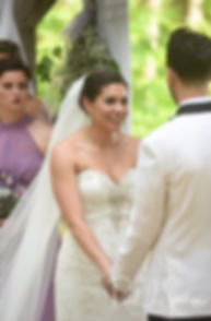 Kendra looks at Joe during her May 2018 wedding ceremony at Crystal Lake Golf Club in Mapleville, Rhode Island.