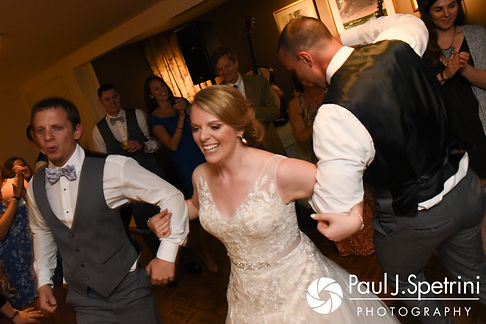 Melissa dances with two groomsmen during her May 2017 wedding reception at Independence Harbor in Assonet, Massachusetts.