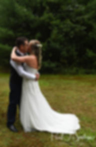 Josh and Kim kiss prior to their September 2018 wedding ceremony at their home in Coventry, Rhode Island.