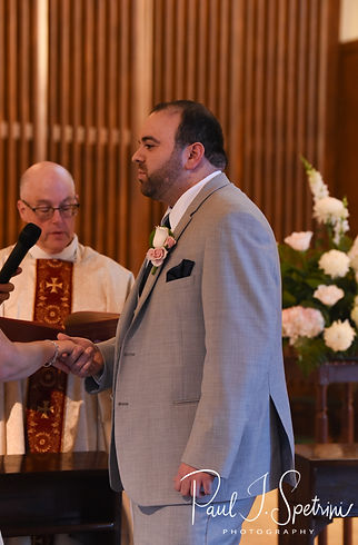 Anthony looks at Sarah during his October 2018 wedding ceremony at St. Augustine Catholic Church in Providence, Rhode island.