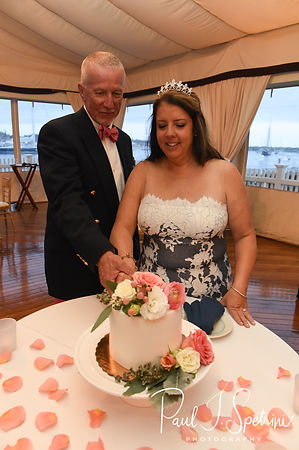 Mike and Kate cut their cake during their May 2018 wedding reception at Regatta Place in Newport, Rhode Island.
