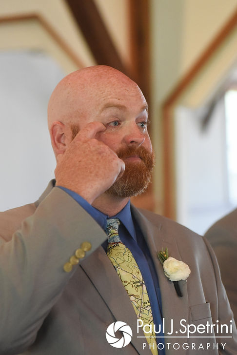 Tim wipes a tear from his eye after seeing Molly for the first time during his June 2017 wedding ceremony at Saint Romuald Chapel in Matunuck, Rhode Island.