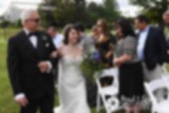 Jen walks down the aisle at the start of her September 2016 wedding at the Roger Williams Park Botanical Center in Providence, Rhode Island.