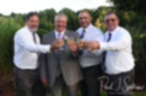 Rick poses for a formal photo with friends following their August 2018 wedding ceremony at Twelve Acres in Smithfield, Rhode Island.
